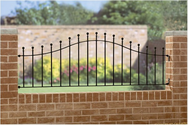 professionally fitted black metal railing on a brick wall